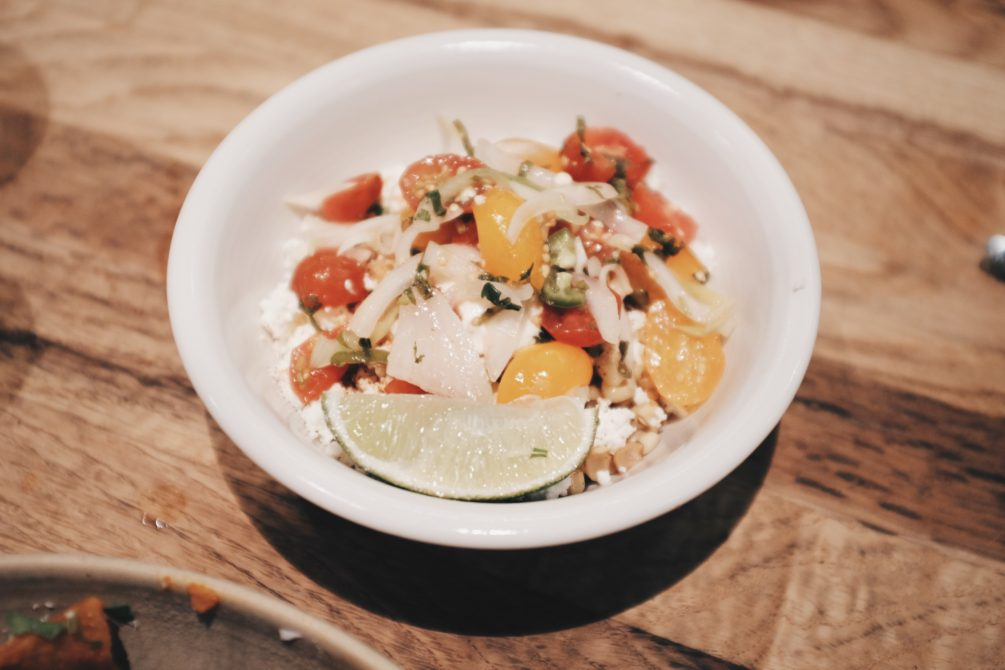 esquite - toasted sweet corn, mayo, queso fresco, chile, lime and cherry tomato pico de gallo