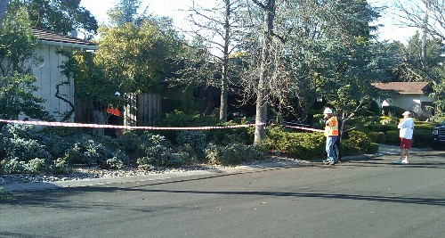 Investigating behind yellow tape - Sound of explosion at Belblossom and Westhill, gardener injured, in east Los Gatos
