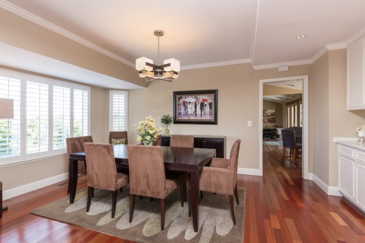 Spacious formal dining with plenty of function in the elegantly framed built in cabinets.