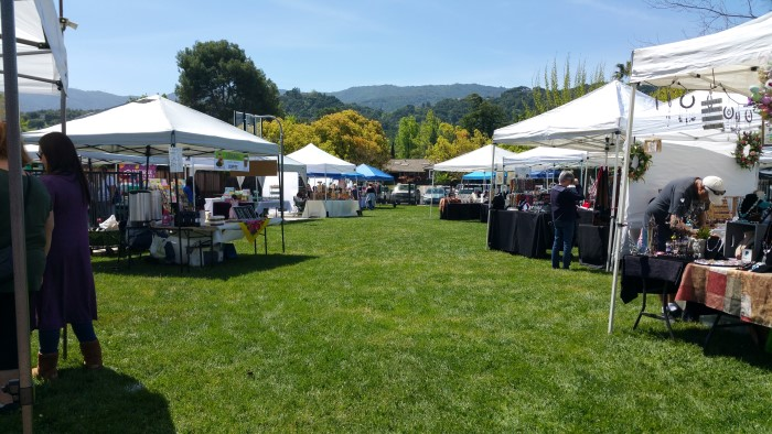Belwood Craft Fair stalls with hills in the background