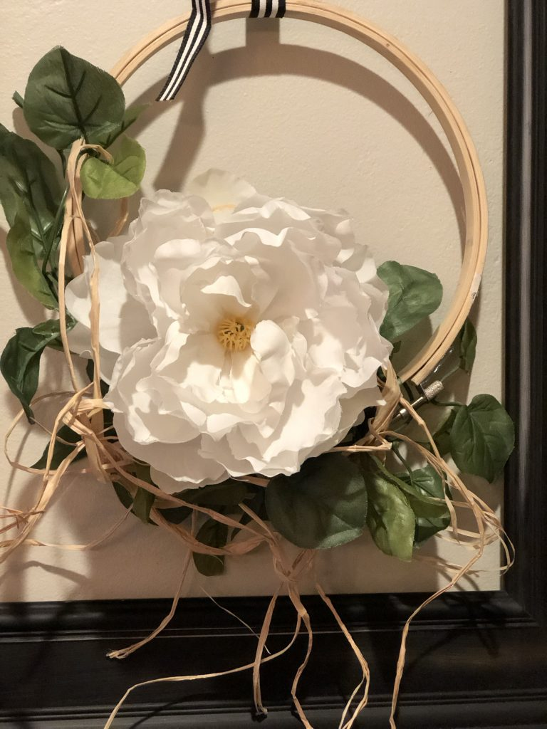 Embroidery hoop fall wreath with flower and raffia