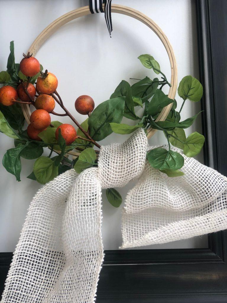 Elegant farmhouse fall wreath with simple burlap bow