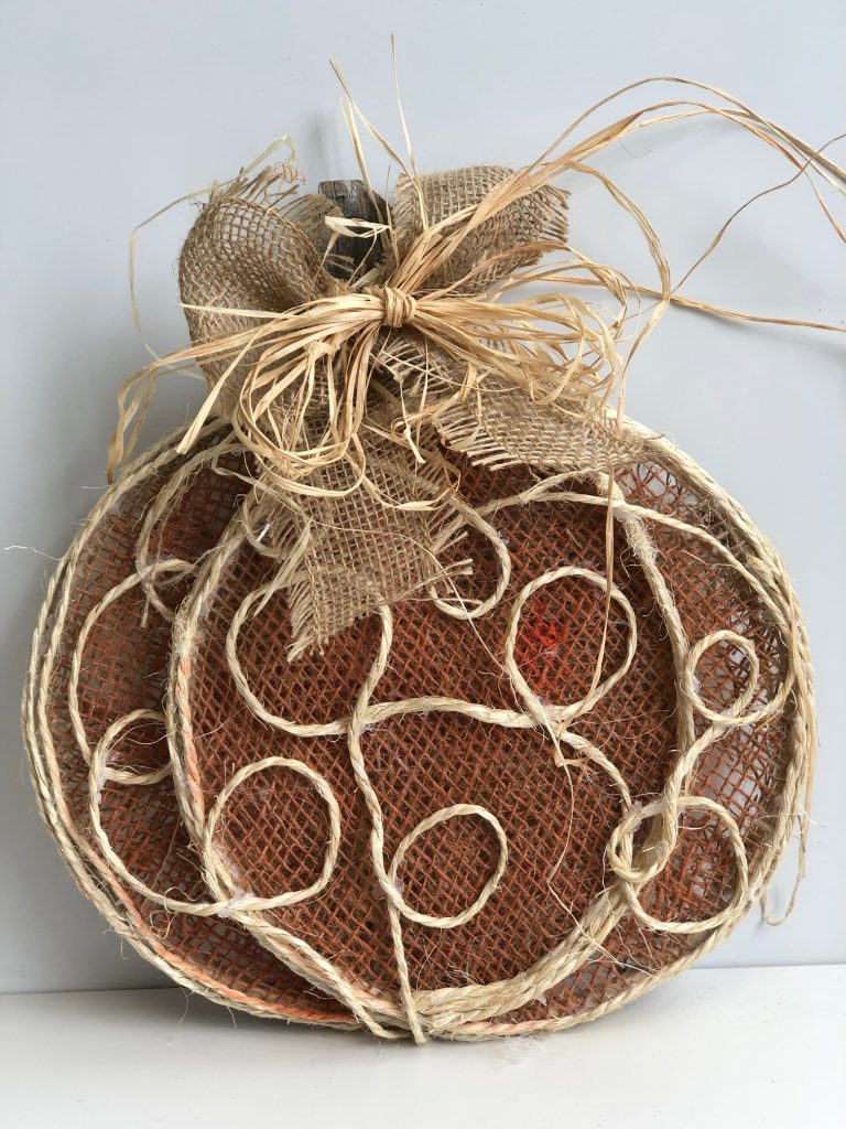 Cutest pumpkin in town! Get ready for the fall with this easy to follow DIY. Learn how to make burlap pumpkin with burlap and raffia bow.