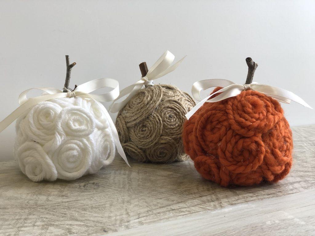 Stunning elegant white ,tan and orange mini pumpkins made out of yarn or twine. Simple satin bow. Fall decor diy