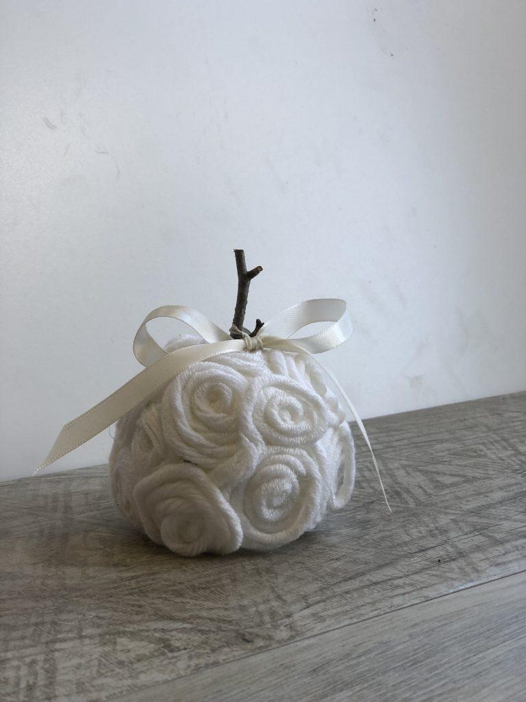 Stunning elegant white, mini pumpkin made out of yarn or twine. Simple satin bow. Beautiful easy fall diy