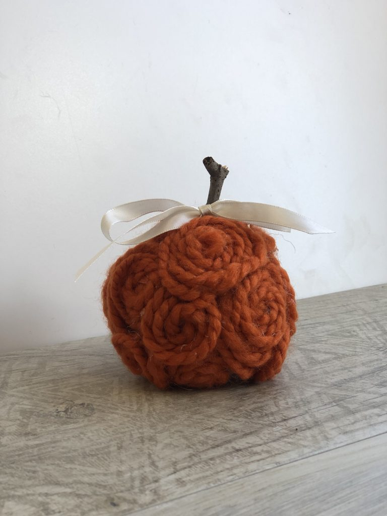 Stunning, elegant orange mini pumpkins made out of yarn or twine. Simple satin bow. Fall decor diy