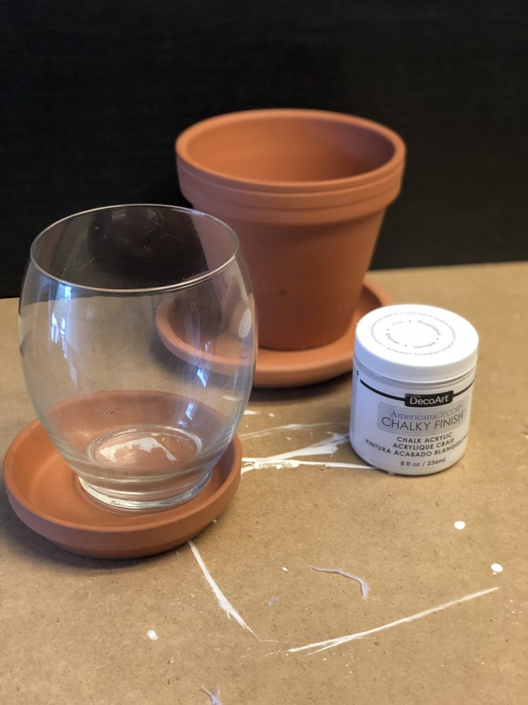 Learn how to make MacKenzie Childs like Snow Globe Gumball machine out terra cotta pots!