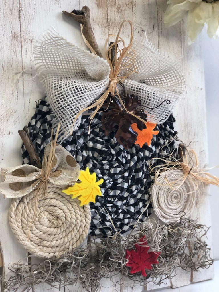Buffalo check fabric pumpkin on the wooden board. Easy fall tutorial. Easy bow tutorial #fallpumpkin #fabricpumpkin #fallhomedecor #fallidea