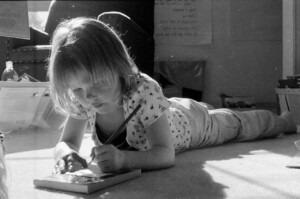 little girl learning in sunlight