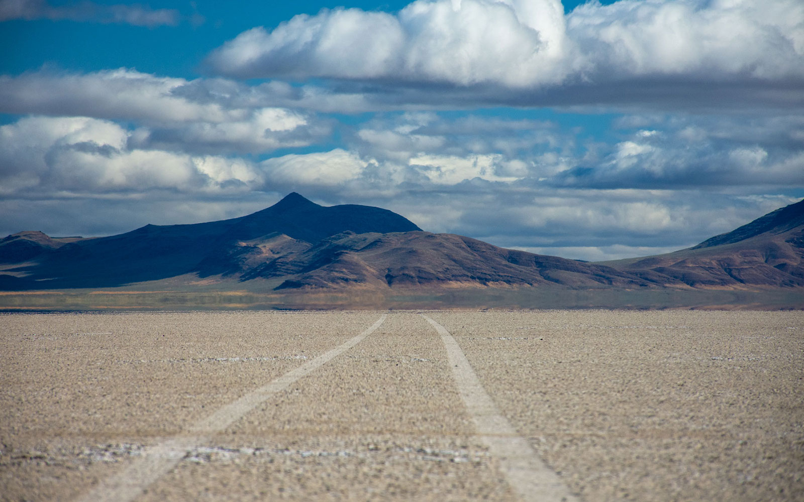 Car tracks into the distance at the Alvord Desert, Oregon