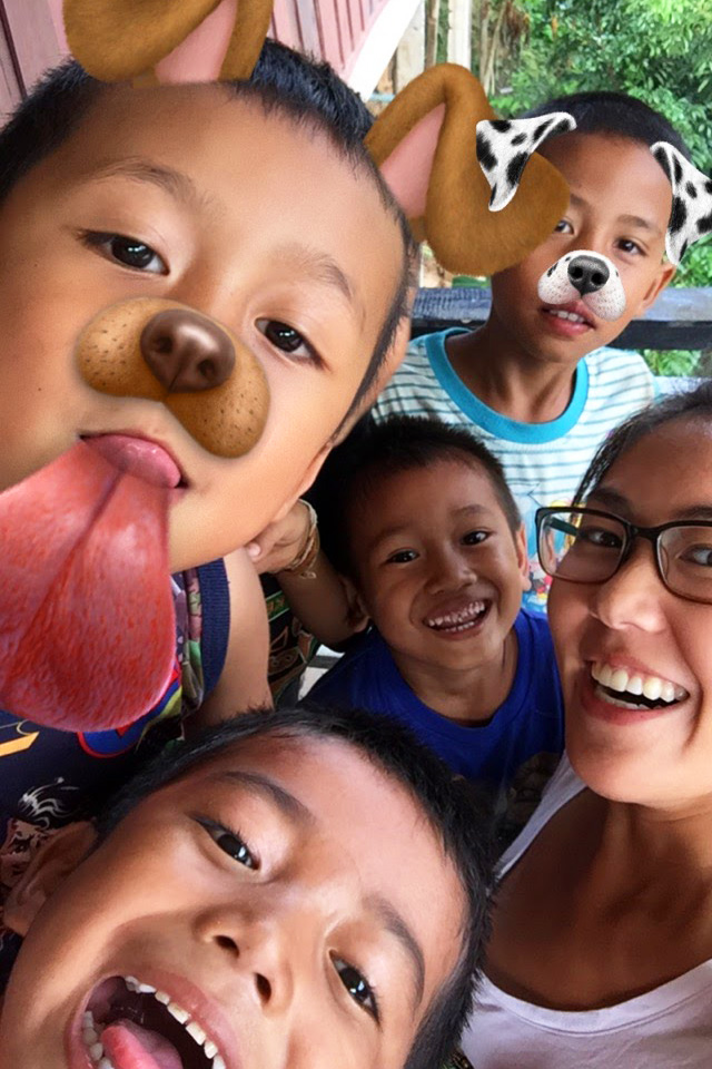 Laotian kids playing with Snapchat