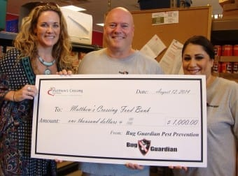 Bug Guardian Pest Prevention donation to Food Bank