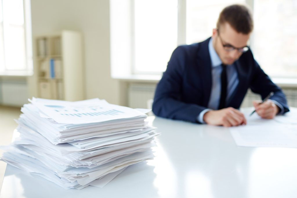 This is an Image of Someone Completing Document Review