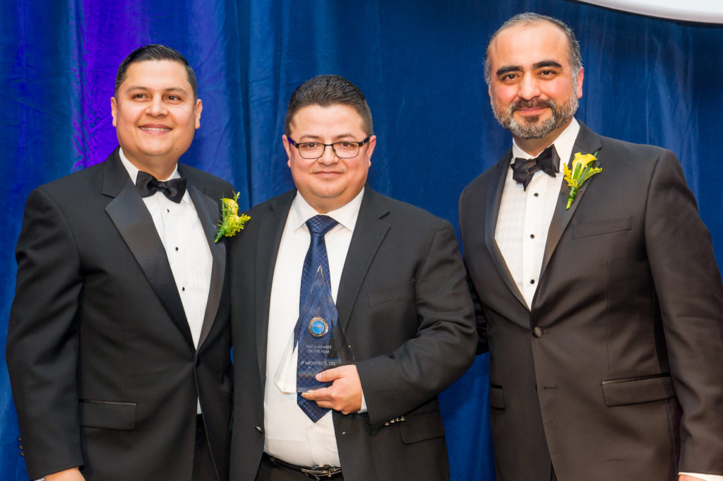 Jose posing with HACIA Leadership after winning Member of the Year
