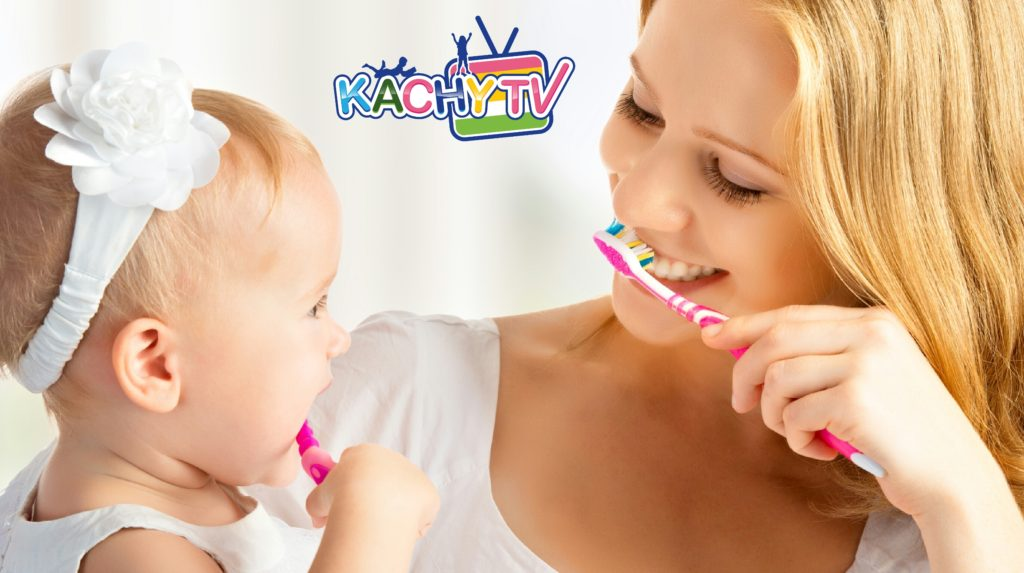 How do you teach kids to brush teeth?