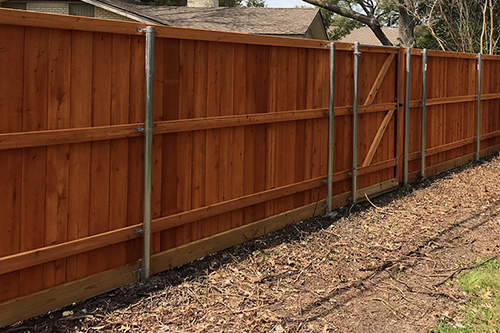 Example of 6 foot wooden fence with steel posts, resident view