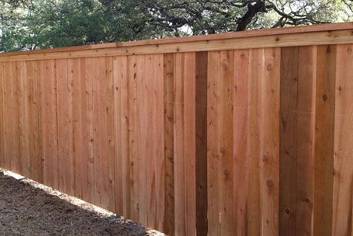 Example of 6 foot wooden fence with cap rail, street view
