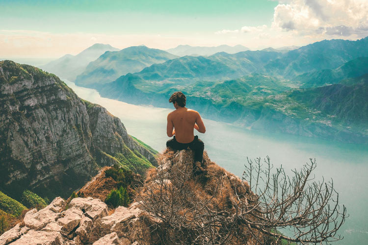 Man on a mountain being himself