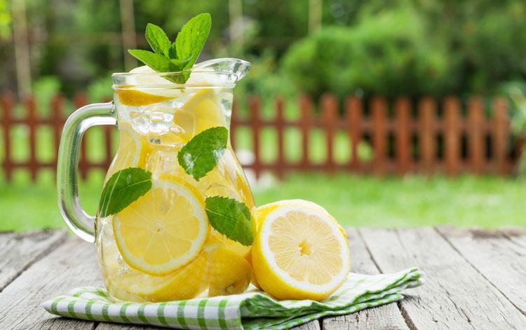 a pitcher of warm lemon water
