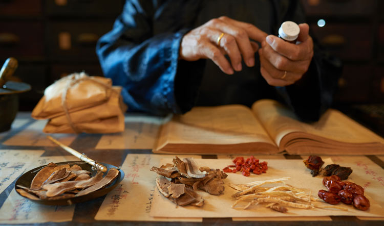 chinese medicine practitioner making a remedy