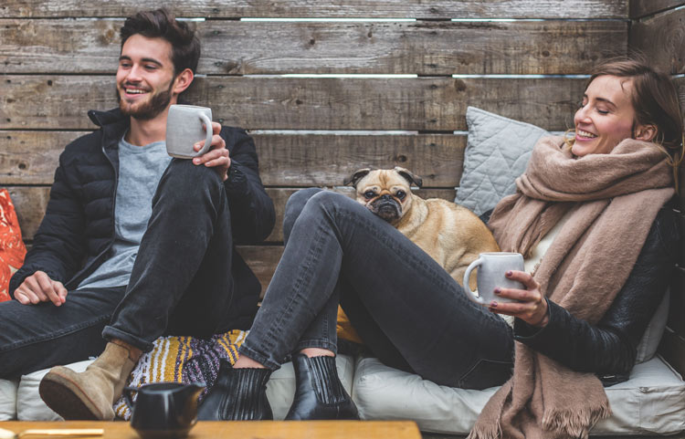 relaxing completely stress free people with coffee and a pug