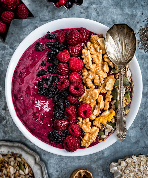 mixed berry smoothie bowl with raspberries and walnuts