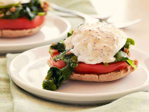 Healthy kale and tomato eggs benedict