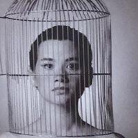 As Hedda Gabler with Bird cage on head