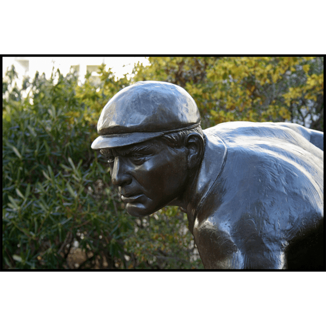 closeup photo of bronze sculpture of Cy Young