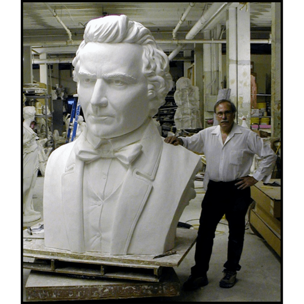 photo of Robert Shure with monumental plaster bust of Donald McKay