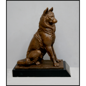 photo of bronze-colored seated husky on black base