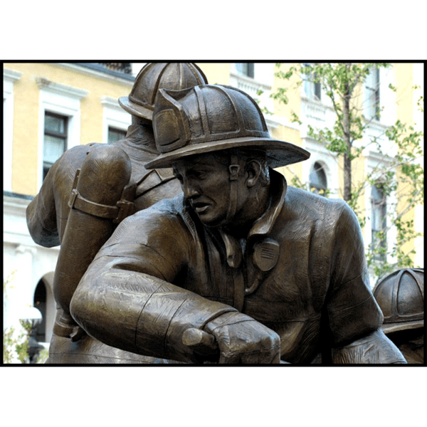 detail photo of bronze sculpture of firefighter in action stance