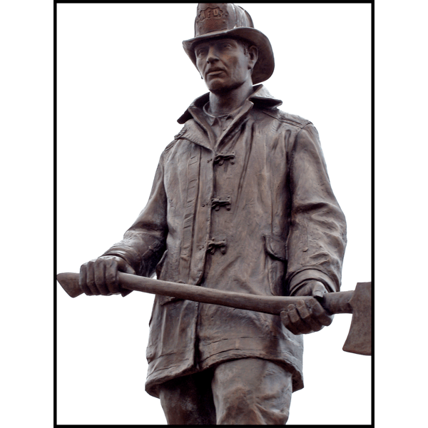 detail photo of bronze statue of standing firefighter holding an ax