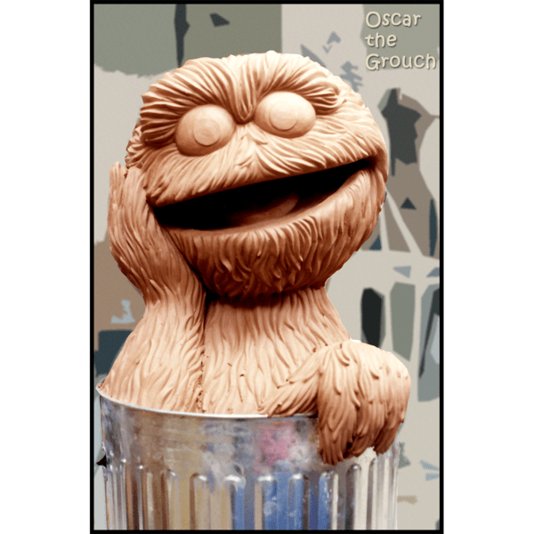 photo of clay model of sculpture of Oscar the Grouch in a trash can