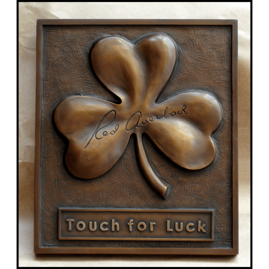 bronze relief sculpture of shamrock with Red Auerbach's signature
