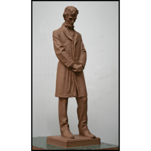 photo of clay model sculpture of Abraham Lincoln standing with hands clasped at his waist