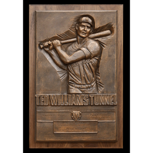 photo of bronze relief of Ted Williams batting on wood mount