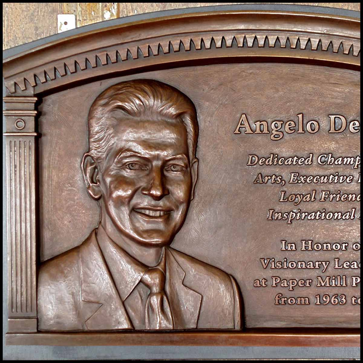 photo of bronze-colored relief plaque of bust of Angelo Del Rossi