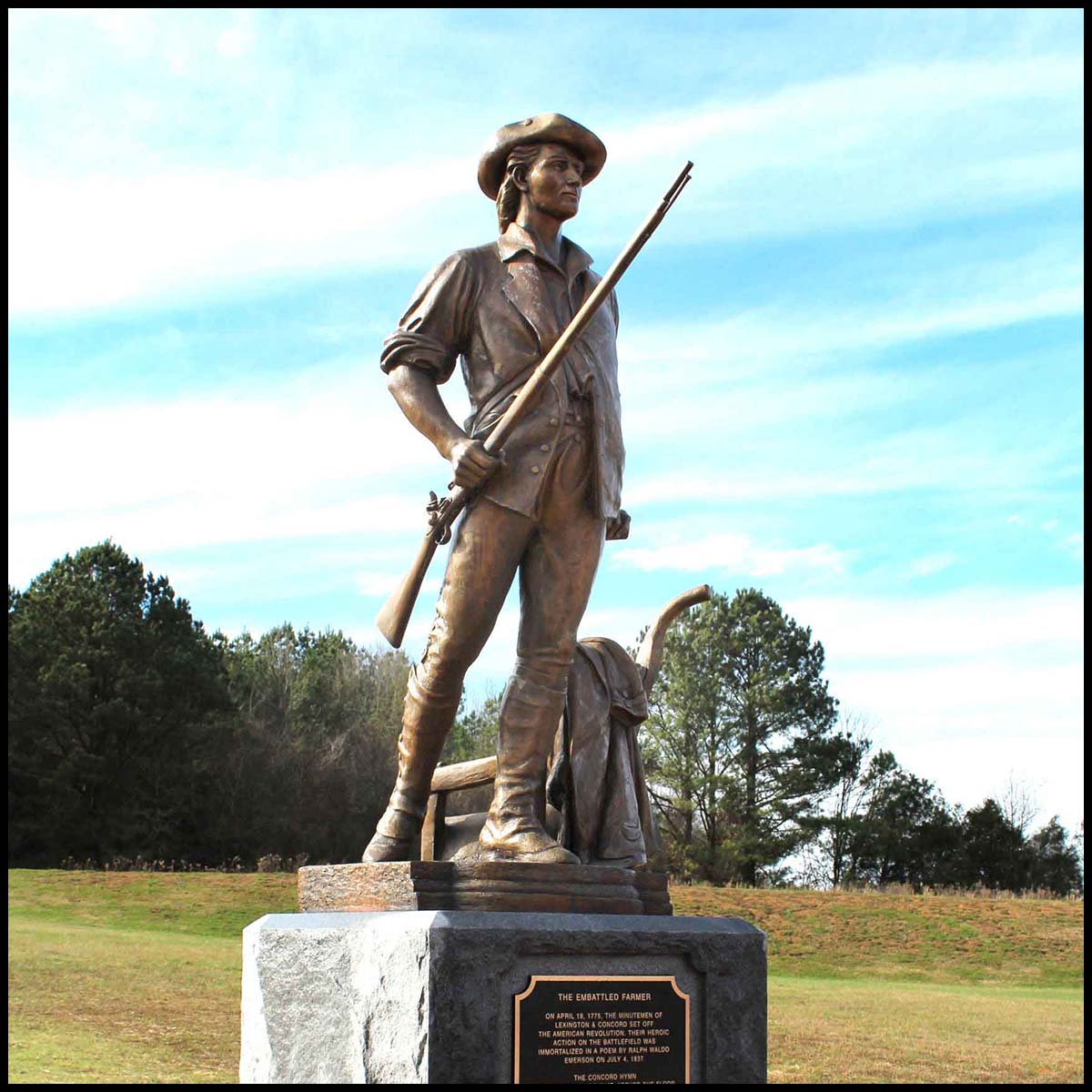 exterior photo of bronze sculpture of Minuteman on stone base