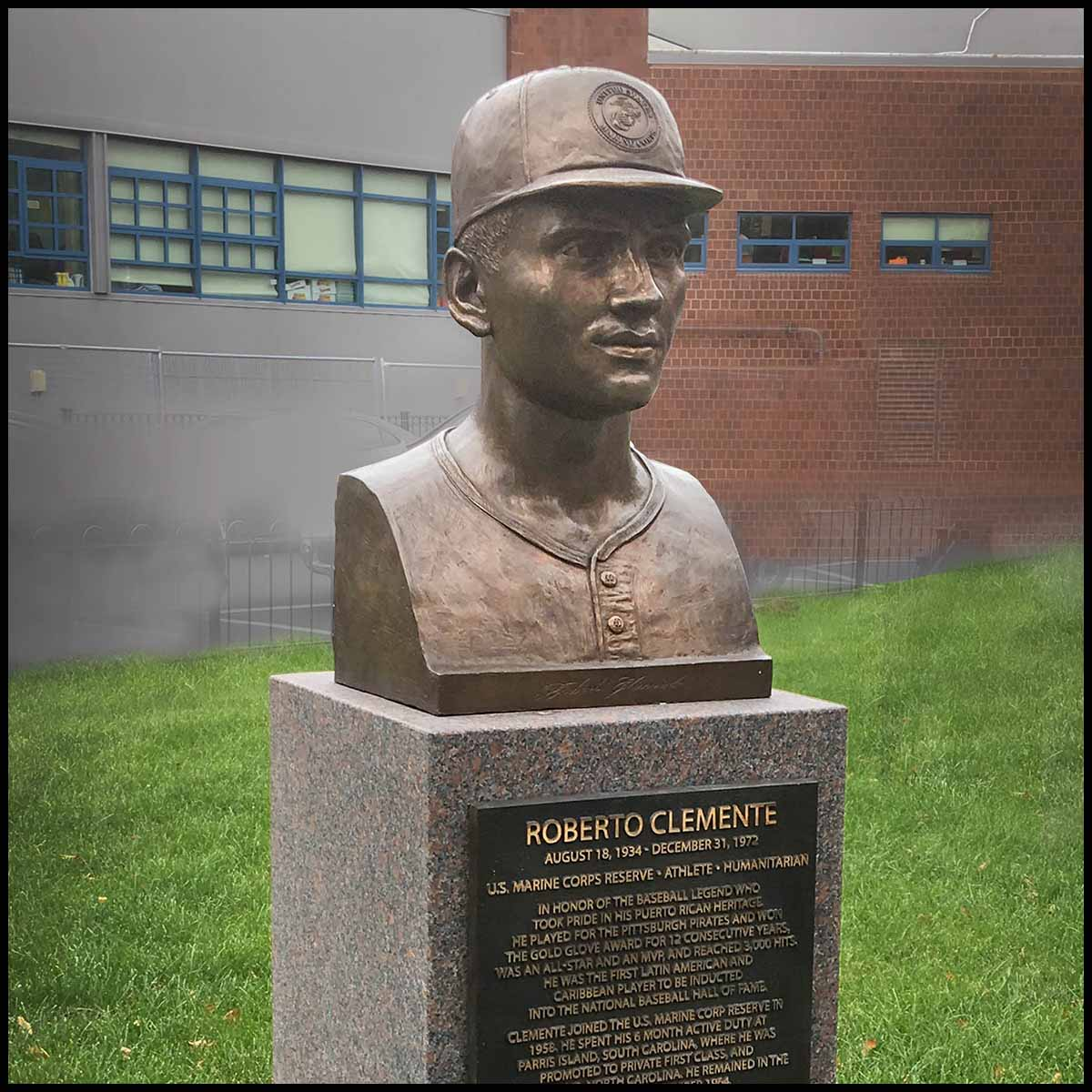 photo of bronze portrait bust sculpture of Roberto Clemente on granite base with bronze plaque