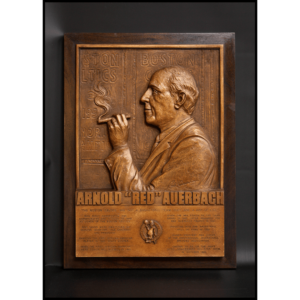 photo of bronze plaque of Red Auerbach profile on a wood mount