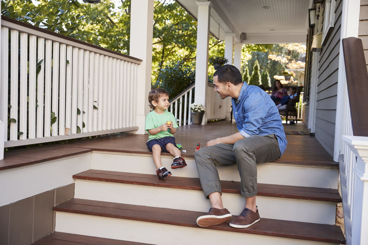 porches porches Porches VS Patios father and son sit on porch of house playing with PWCPYLT