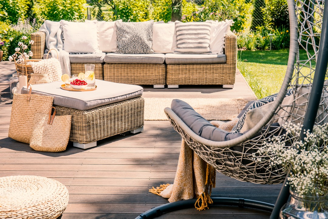 patios patios Patios For Summer Gatherings pillows on rattan couch near table on patio with h 2FQ3BKL 1