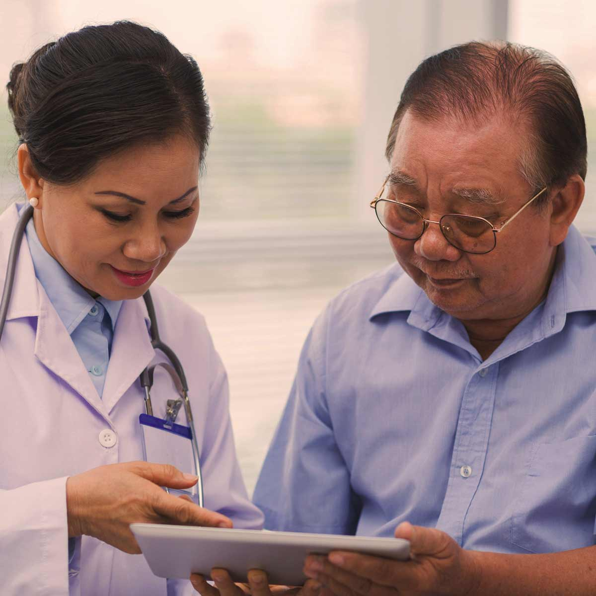 Oncologist doctor talking with patient