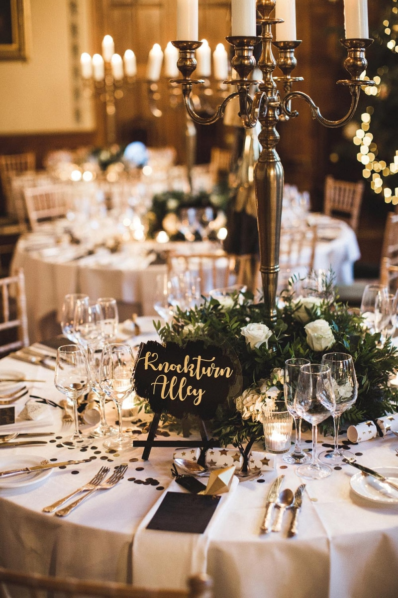 Harry Potter wedding table with a Knockturn Alley sign in Houston Texas