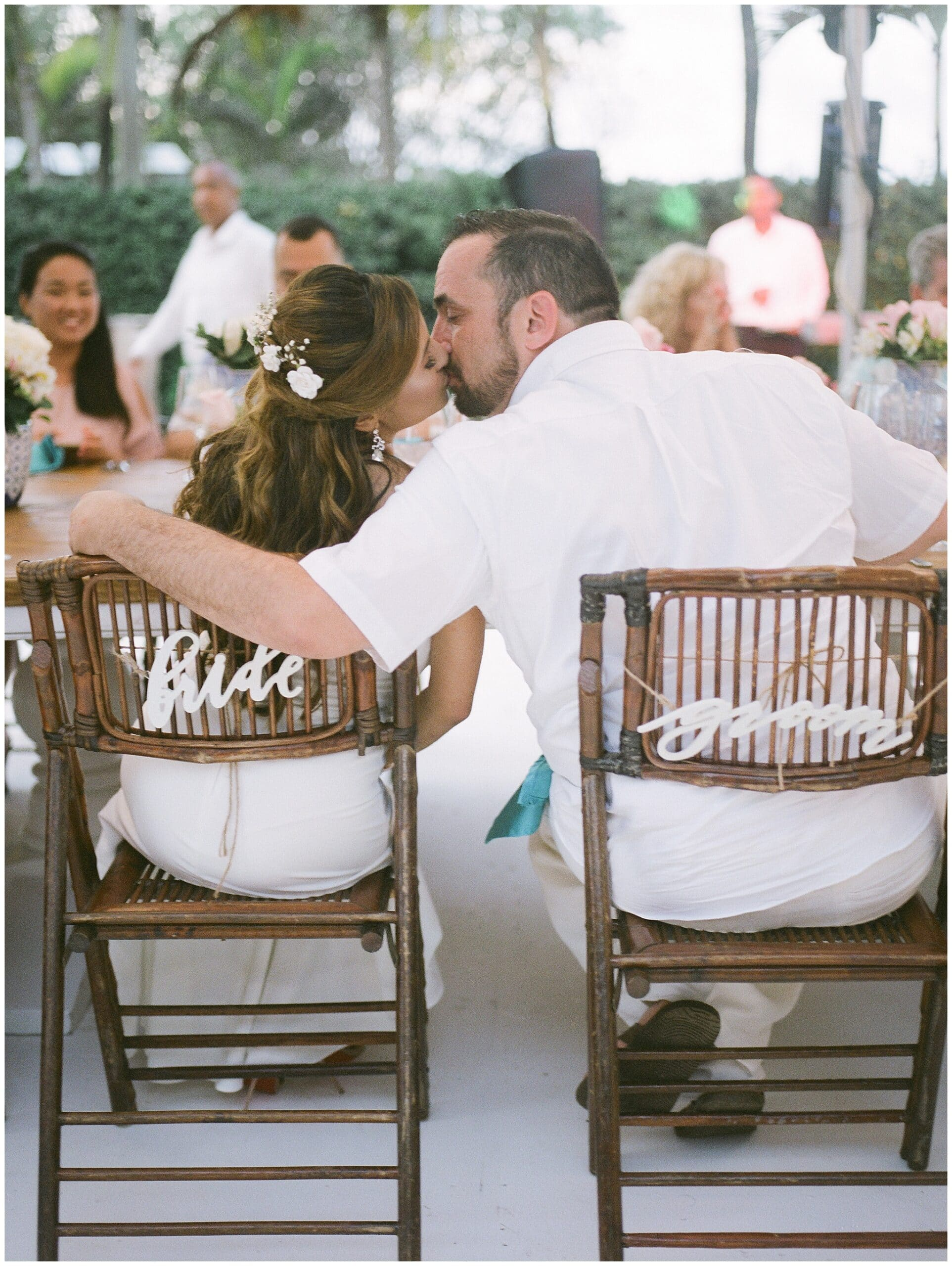 bride and groom kissing at a micro wedding at Houston Arboretum in Houston Texas by Swish and Click Photography