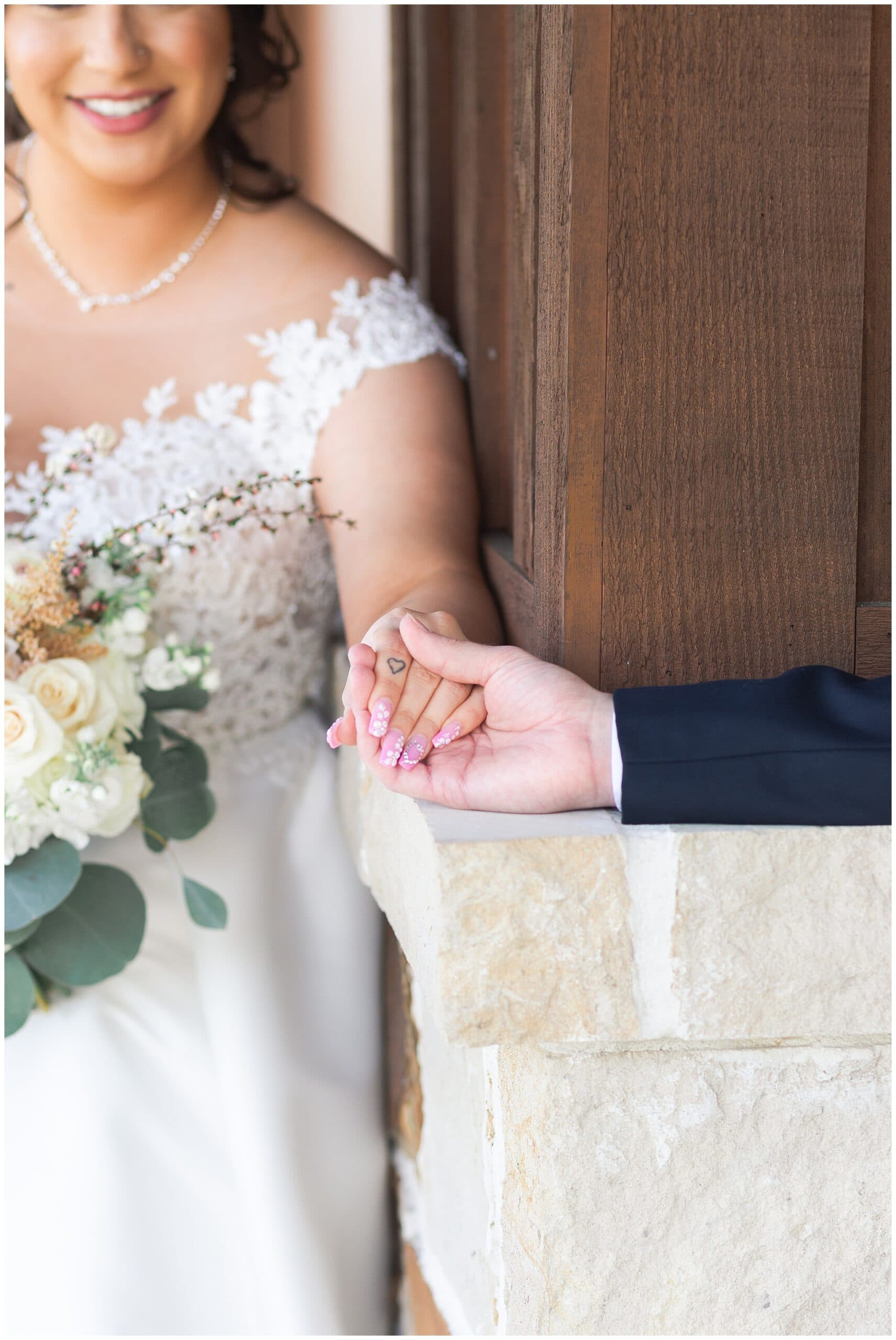 first look between bride and groom at Bridal Oaks in Cypress Texas by Houston wedding photographer Swish and Click Photography