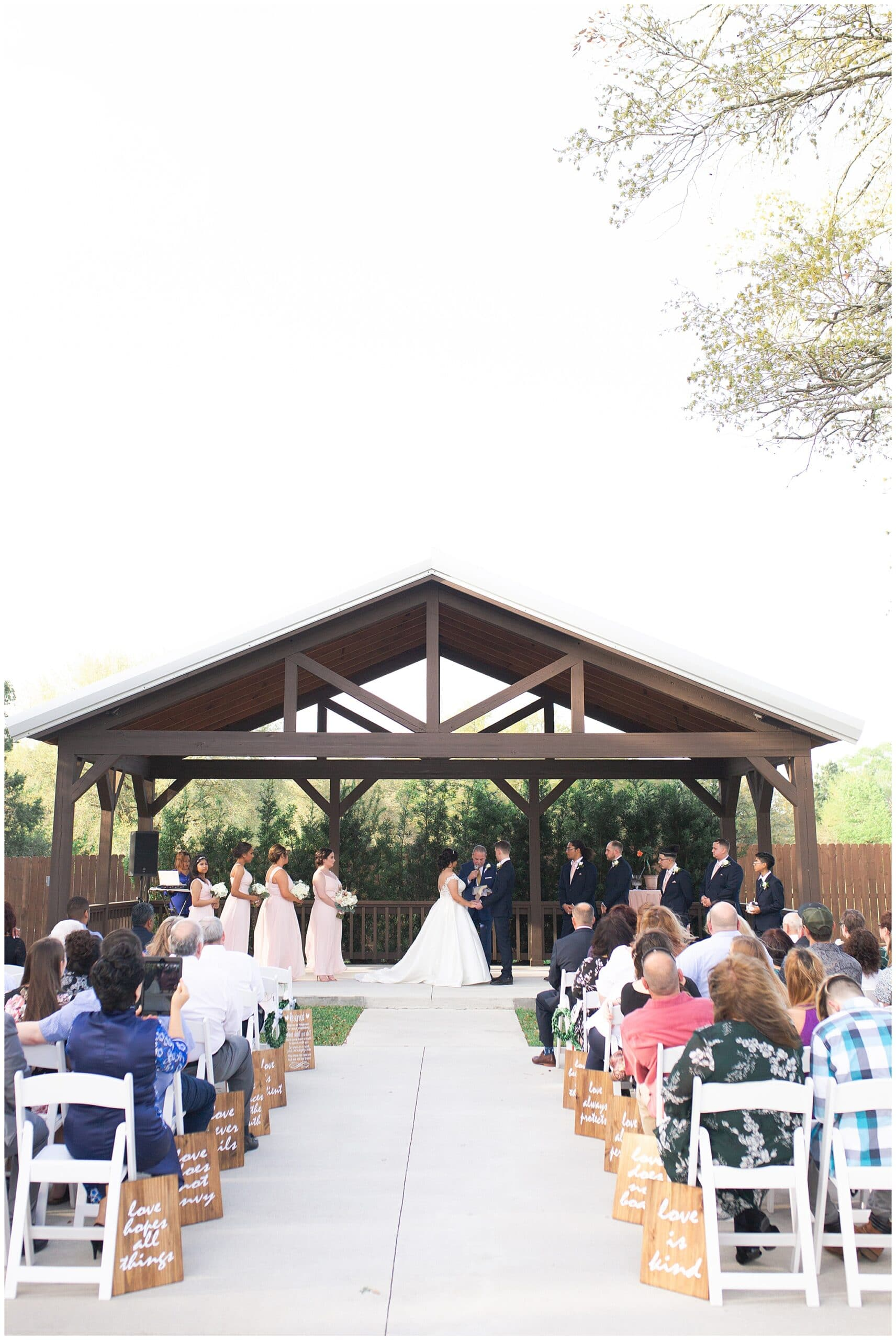 wedding ceremony at Bridal Oaks in Cypress Texas by Houston wedding photographer Swish and Click Photography