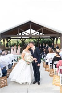 bride and groom kiss at Bridal Oaks in Cypress Texas by Houston wedding photographer Swish and Click Photography