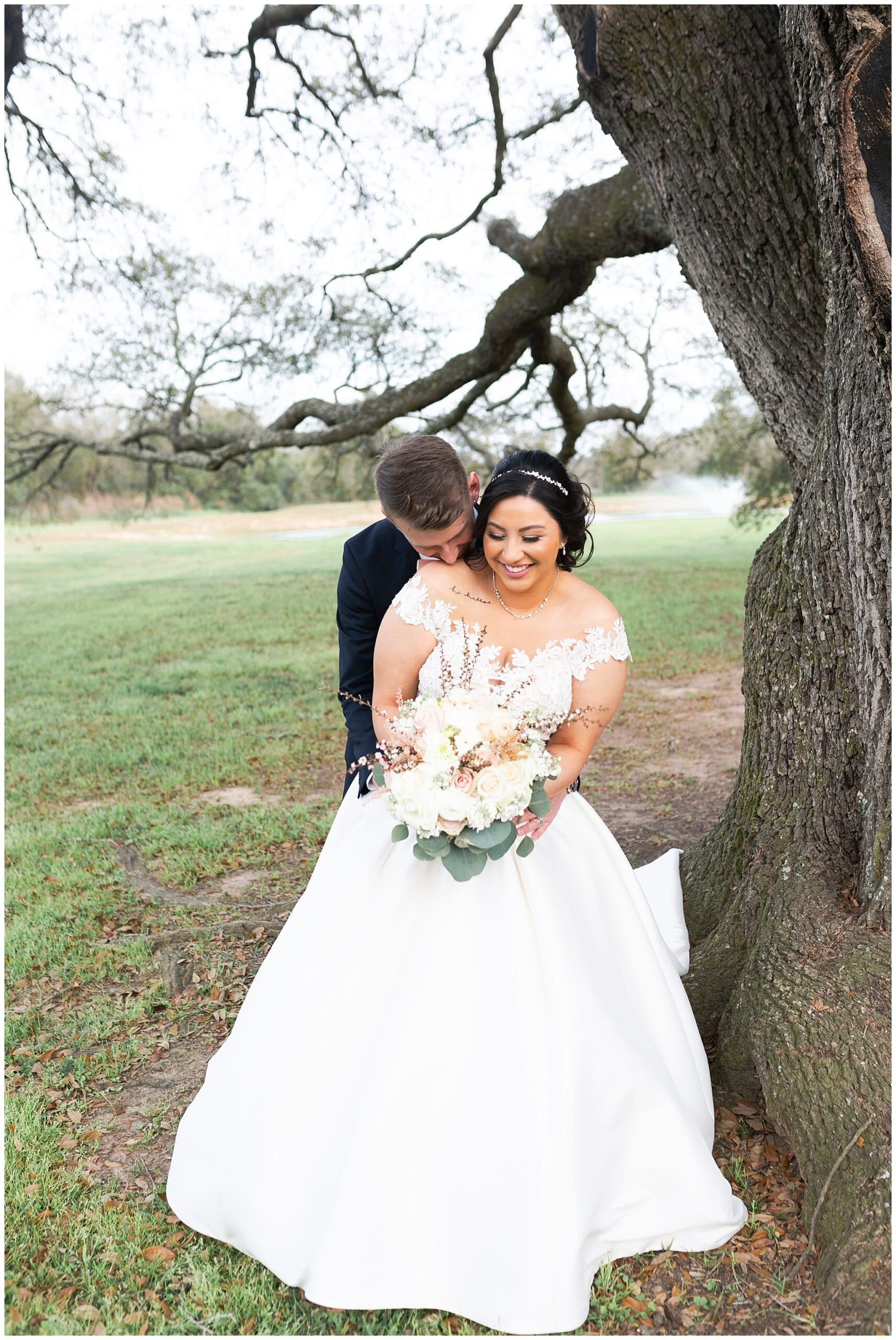 bride and groom portraits at Bridal Oaks in Cypress Texas by Houston wedding photographer Swish and Click Photography